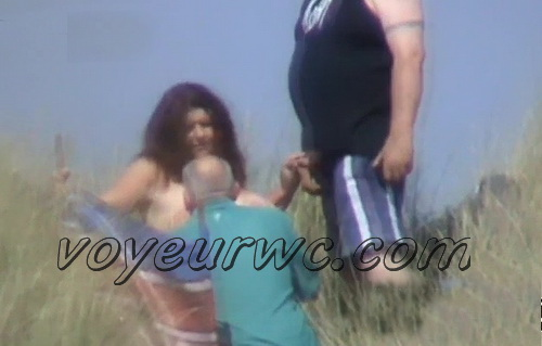 Outdoor sex filmed through the bushes by a voyeur. Big boobs on the beach (UK Night Man - Day Watching 01-02)