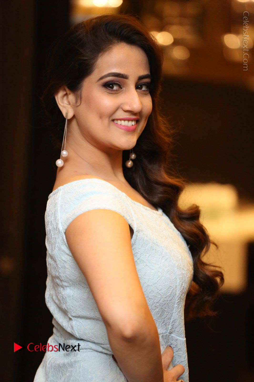 Manjusha Stills in Short Dress at Dhruva Salute to Audience Event
