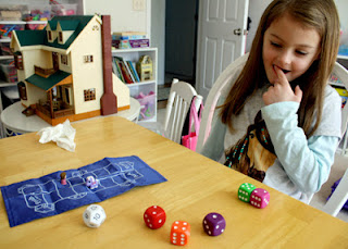 Tessa used the numbers five, two, four and one to create a combination of four dice that added up to equal twelve on the target die. As a reward, she got to advance four spaces on the scoring track.