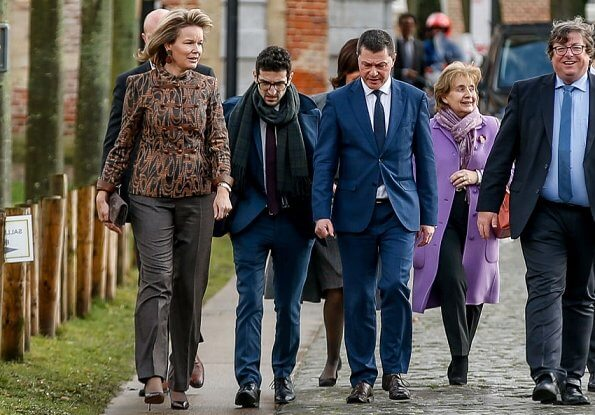 Queen Mathilde visited The Alamire Foundation's House of Polyphony located in the Park Abbey in Heverlee. Armani print jacket