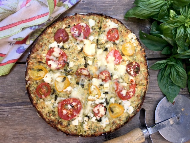 Zucchini crust pizza has great flavour and texture and is a great alternative to bread-based pizza crust. It takes just minutes to mix up. The crust can be made several days ahead and reheated with the toppings.