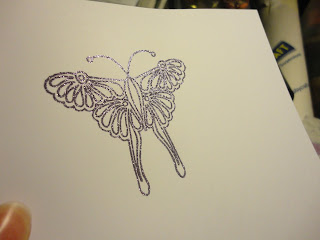 Glittery purple butterfly stamped image