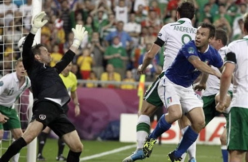 Italy forward Antonio Cassano heads in the opening goal past Irish goalkeeper Shay Given