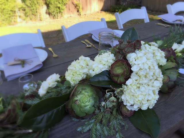 Kinfolk style wedding centerpiece with White flowers and Succulents