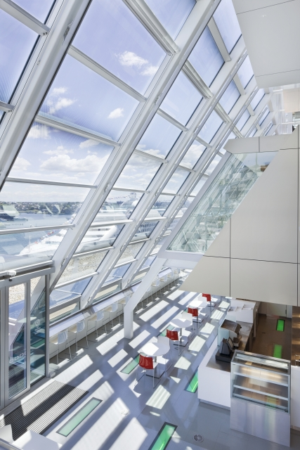 Photo of rooftop office with huge glass wall