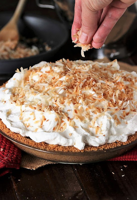Topping Coconut Cream Pie with Toasted Coconut Image