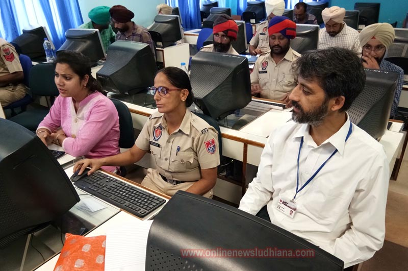 Police officials learning advanced computer skills during Computer Training workshop at PCTE