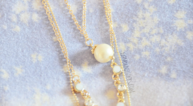 Details on the 3-tier layered golden chain necklace from Born Pretty Store--this elegant boho-chic piece features a quartz pendant, rhinestone embellishment, and pearl accent.