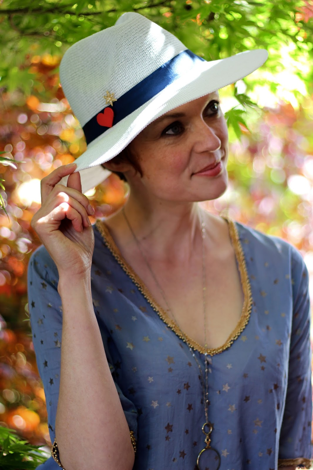 Somerville scarves blue kaftan & white panama hat | Fake Fabulous
