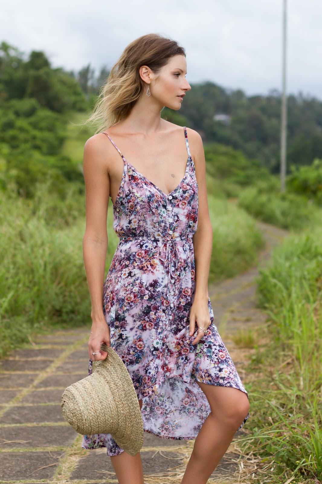 Fashion and travel blogger, Alison Hutchinson, is wearing a floral print bohemian KAYVALYA dress at the Ridge Walk in Ubud, Bali