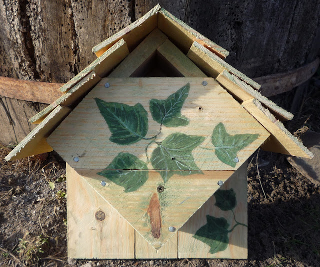 Home-made repurposed wood wild bird nesting box