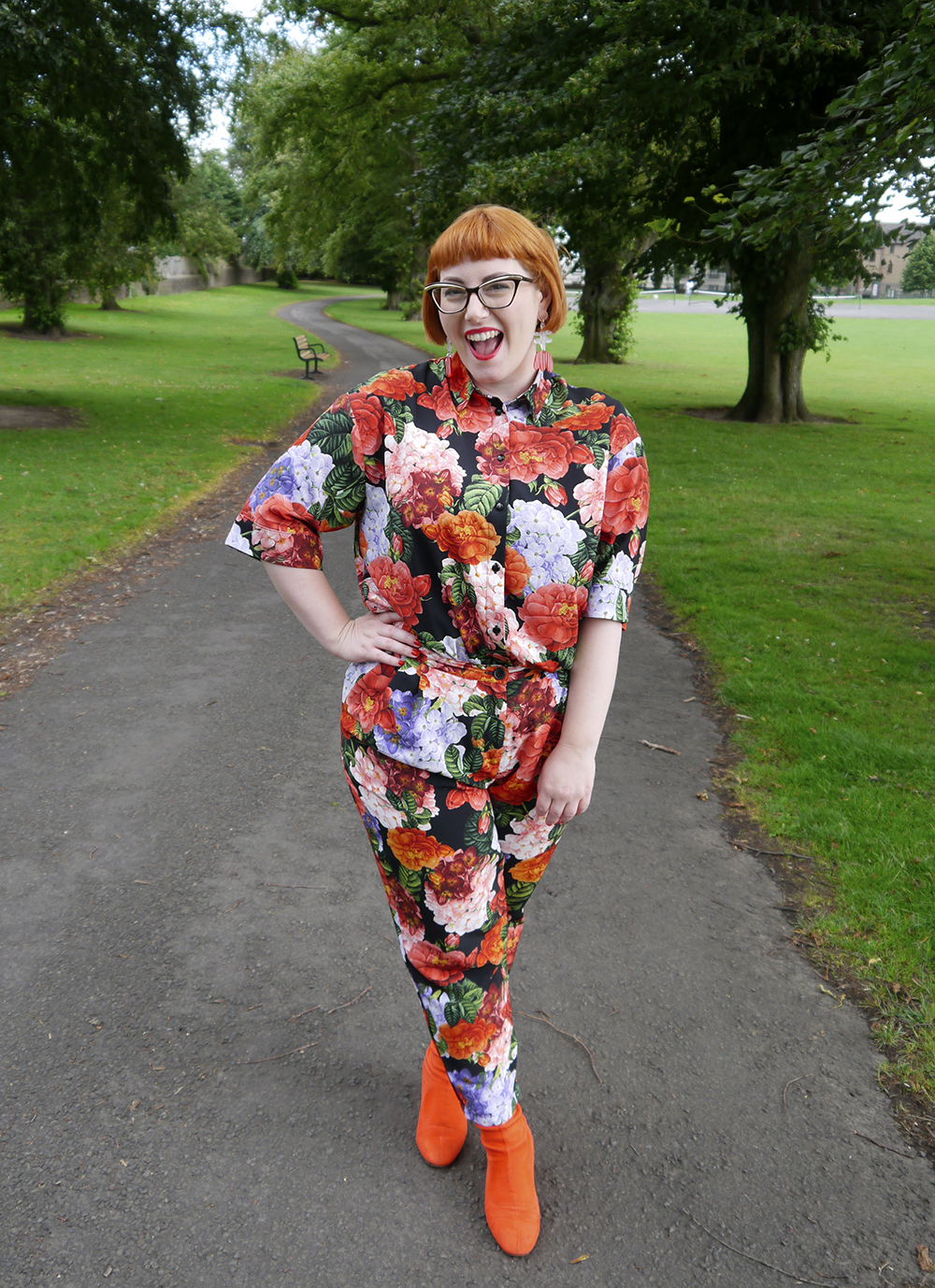 Scottish blogger Helen from Wardrobe Conversations wear matching floral shirt and trousers with red boots and Julia de Klerk earrings
