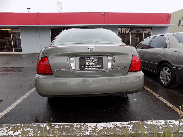 2004 Nissan Sentra with whole car paint job from Almost Everything Auto Body.