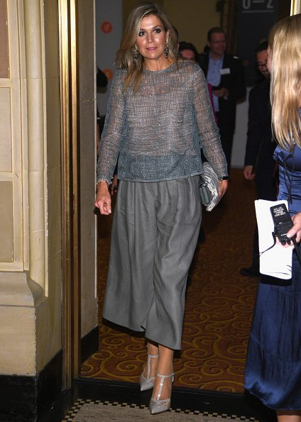 Queen Maxima wore Natan lace top and Natan satin pants. Queen Maxima wore Jan Taminiau shoes. Jan Taminiau clutch