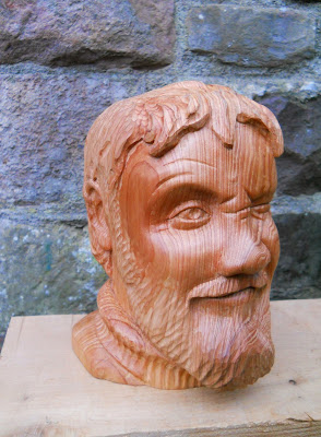 carved wooden self portrait