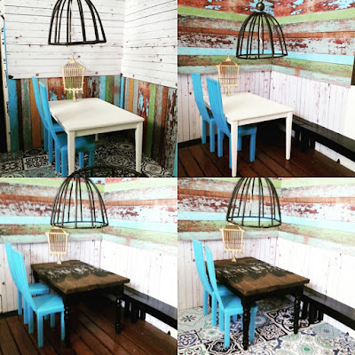 Four versions of a modern miniature scene comprising two blue chairs, a dining table and an industrial-style light fitting. The wall and floor treatments vary between the pictures.
