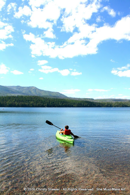 My son makes his way out onto the lake in the green kayak.