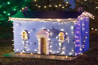 A mineature house with lights as part of the Trail of Lights in Austin, Texas