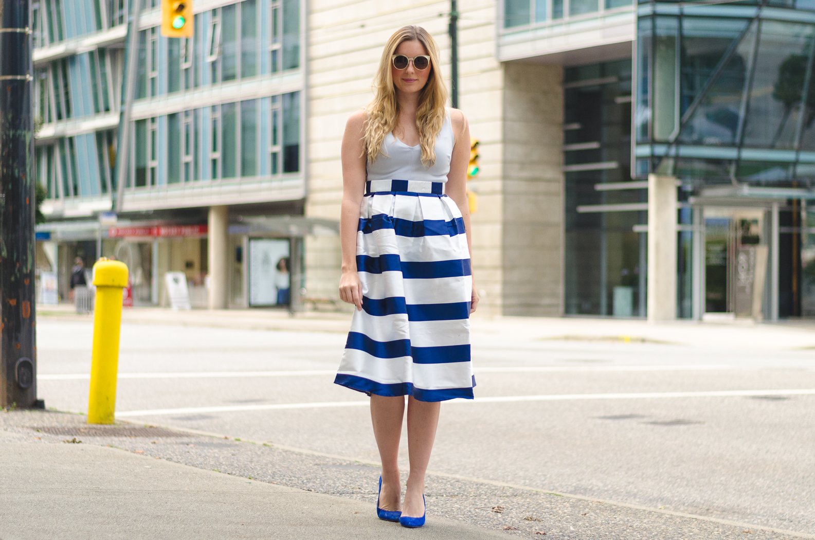 the urban umbrella style blog, vancouver style blog, vancouver fashion blog, vancouver lifestyle blog, vancouver health blog, vancouver fitness blog, vancouver travel blog, canadian faashion blog, canadian style blog, canadian lifestyle blog, canadian health blog, canadian fitness blog, canadian travel blog, bree aylwin, chicwish a-line striped midi skirt in navy, how to style a striped skirt, how to style a midi skirt, what to wear with a midi skirt, polette gold sunglasses, how to style stripes, best midi skirt outfit ideas, midi skirt outfit, best lifestyle blogs, best fitness blogs, best health blogs, best travel blogs, top fashion blogs, top style blogs, top lifestyle blogs, top fitness blogs, top health blogs, top travel blogs