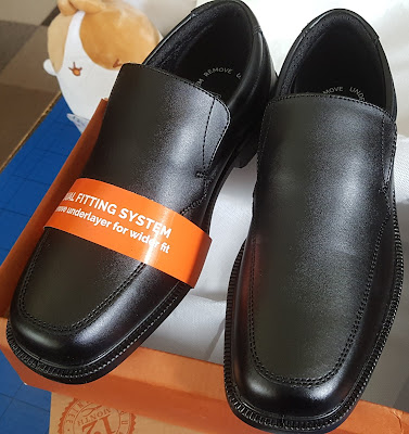 Black slip on boys school shoes in box ready for wearing and review