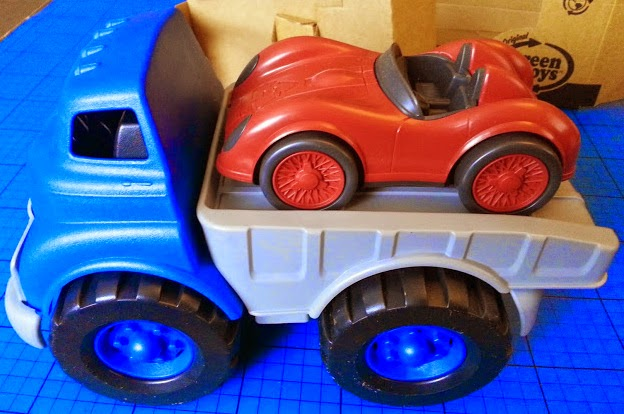 Recycled Plastic Toy Blue Flatbed Truck and Red Racing Car
