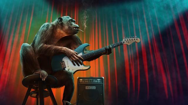 immagine di una scimmia mentre suona la chitarra