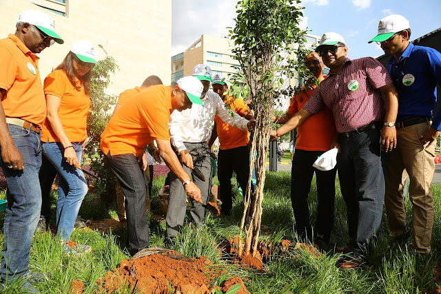 Pradeep Lala, CEO, Embassy Services planting a tree
