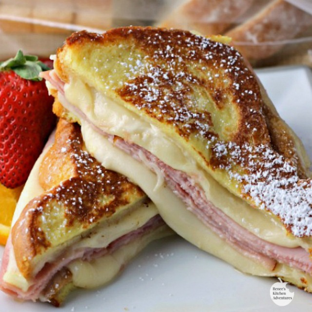Monte Cristo Style Grilled Cheese Sandwich by Renee's Kitchen Adventures is an easy recipe for a grilled cheese sandwich made with ham and swiss then fried like french toast. Serve for breakfast, brunch, lunch, or dinner.