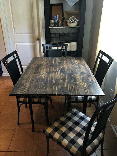 Vintage Paint and more... thrift store table and chairs after being upcycled with black chalk paint and some black and cream buffalo plaid fabric