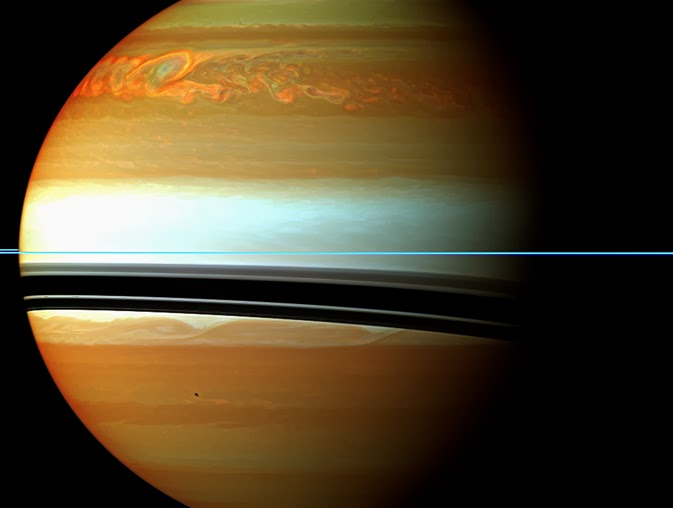 "Saturn  Designations Adjective Saturnian, Cronian Orbital characteristics Epoch J2000.0 Aphelion  1,513,325,783 km 10.115 958 04 AU Perihelion  1,353,572,956 km 9.048 076 35 AU Semi-major axis  1,433,449,370 km 9.582 017 20 AU Eccentricity 0.055 723 219 Orbital period  10,759.22 days 29.4571 yr 24,491.07 Saturn solar days Synodic period 378.09 days Average orbital speed 9.69 km/s Mean anomaly 320.346 750° Inclination  2.485 240° to Ecliptic 5.51° to Sun's equator 0.93° to invariable plane Longitude of ascending node 113.642 811° Argument of perihelion 336.013 862° Satellites ~ 200 observed (62 with secure orbits including 53 that are named) Physical characteristics Equatorial radius  60,268 ± 4 km 9.4492 Earths Polar radius  54,364 ± 10 km 8.5521 Earths Flattening 0.097 96 ± 0.000 18 Surface area  4.27×1010 km² 83.703 Earths Volume  8.2713×1014 km3 763.59 Earths Mass  5.6846×1026 kg 95.152 Earths Mean density 0.687 g/cm3 (less than water) Equatorial surface gravity  10.44 m/s² 1.065 g Escape velocity 35.5 km/s Sidereal rotation period 10.57 hours (10 hr 34 min) Equatorial rotation velocity  9.87 km/s 35,500 km/h Axial tilt 26.73° North pole right ascension  2h 42m 21s 40.589° North pole declination 83.537° Albedo  0.342 (Bond) 0.47 (geometric) Surface temp.    1 bar level    0.1 bar  min mean max 134 K  84 K  Apparent magnitude +1.47 to -0.24 Angular diameter 14.5""–20.1"" (excludes rings) Atmosphere Scale height 59.5 km Composition  ~96% hydrogen (H2) ~3% helium ~0.4% methane ~0.01% ammonia ~0.01% hydrogen deuteride (HD) 0.000 7% ethane Ices:  ammonia water ammonium hydrosulfide(NH4SH) Saturn is the sixth planet from the Sun and the second largest planet in the Solar System, after Jupiter. Named after the Roman god Saturn, its astronomical symbol (?) represents the god's sickle. Saturn is a gas giant with an average radius about nine times that of Earth. While only one-eighth the average density of Earth, with its larger volume Saturn is just over 95 times as massive as Earth. Saturn's interior is probably composed of a core of iron, nickel and rock (silicon and oxygen compounds), surrounded by a deep layer of metallic hydrogen, an intermediate layer of liquid hydrogen and liquid helium and an outer gaseous layer. The planet exhibits a pale yellow hue due to ammonia crystals in its upper atmosphere. Electrical current within the metallic hydrogen layer is thought to give rise to Saturn's planetary magnetic field, which is slightly weaker than Earth's and around one-twentieth the strength of Jupiter's. The outer atmosphere is generally bland and lacking in contrast, although long-lived features can appear. Wind speeds on Saturn can reach 1,800 km/h (1,100 mph), faster than on Jupiter, but not as fast as those on Neptune. Saturn has a prominent ring system that consists of nine continuous main rings and three discontinuous arcs, composed mostly of ice particles with a smaller amount of rocky debris and dust. Sixty-two known moons orbit the planet; fifty-three are officially named. This does not include the hundreds of ""moonlets"" within the rings. Titan, Saturn's largest and the Solar System's second largest moon, is larger than the planet Mercury and is the only moon in the Solar System to retain a substantial atmosphere.  Contents    1 Physical characteristics 1.1 Internal structure 2 Atmosphere 2.1 Cloud layers 2.2 North pole hexagonal cloud pattern 3 Magnetosphere 4 Orbit and rotation 5 Planetary rings 6 Natural satellites 7 History of exploration 7.1 Ancient observations 7.2 European observations (17th–19th centuries) 7.3 Modern NASA and ESA probes 7.3.1 Pioneer 11 flyby 7.3.2 Voyager flybys 7.3.3 Cassini–Huygens spacecraft 8 Observation 9 In culture 10 See also 11 References 12 Further reading 13 External links  Physical characteristics    Montage roughly comparing the sizes of Saturn and Earth. Saturn is classified as a gas giant planet because the exterior is predominantly composed of gas and it lacks a definite surface, although it may have a solid core. The rotation of the planet causes it to take the shape of an oblate spheroid; that is, it is flattened at the poles and bulges at the equator. Its equatorial and polar radii differ by almost 10%—60,268 km versus 54,364 km, respectively. Jupiter, Uranus and Neptune, the other gas giants in the Solar System, are also oblate, but to a lesser extent. Saturn is the only planet of the Solar System that is less dense than water; about 30% less. Although Saturn's core is considerably denser than water, the average specific density of the planet is 0.69 g/cm3 due to the gaseous atmosphere. Jupiter has 318 times the Earth's mass while Saturn is 95 times the mass of the Earth, yet Jupiter is only about 20% larger than Saturn. Together, Jupiter and Saturn hold 92% of the total planetary mass in the Solar System.  Internal structure Saturn is termed a gas giant, but it is not entirely gaseous. The planet primarily consists of hydrogen, which becomes a non-ideal liquid when the density is above 0.01 g/cm3. This density is reached at a radius containing 99.9% of Saturn's mass. The temperature, pressure and density inside the planet all rise steadily toward the core, which, in the deeper layers of the planet, cause hydrogen to transition into a metal. Standard planetary models suggest that the interior of Saturn is similar to that of Jupiter, having a small rocky core surrounded by hydrogen and helium with trace amounts of various volatiles. This core is similar in composition to the Earth, but more dense. Examination of the gravitational moment of the planet, in combination with physical models of the interior, allowed French astronomers Didier Saumon and Tristan Guillot to place constraints on the mass of the planet's core. In 2004, they estimated that the core must be 9–22 times the mass of the Earth, which corresponds to a diameter of about 25,000 km. This is surrounded by a thicker liquid metallic hydrogen layer, followed by a liquid layer of helium-saturated molecular hydrogen that gradually transitions into gas with increasing altitude. The outermost layer spans 1000 km and consists of a gaseous atmosphere. Saturn has a very hot interior, reaching 11,700 °C at the core, and the planet radiates 2.5 times more energy into space than it receives from the Sun. Most of this extra energy is generated by the Kelvin–Helmholtz mechanism of slow gravitational compression, but this alone may not be sufficient to explain Saturn's heat production. An additional mechanism may be at play whereby Saturn generates some of its heat through the ""raining out"" of droplets of helium deep in its interior. As the droplets descend through the lower-density hydrogen, the process releases heat by friction and leaves the outer layers of the planet depleted of helium. These descending droplets may have accumulated into a helium shell surrounding the core.  Atmosphere  The outer atmosphere of Saturn contains 96.3% molecular hydrogen and 3.25% helium. The proportion of helium is significantly deficient compared to the abundance of this element in the Sun. The quantity of elements heavier than helium are not known precisely, but the proportions are assumed to match the primordial abundances from the formation of the Solar System. The total mass of these heavier elements is estimated to be 19–31 times the mass of the Earth, with a significant fraction located in Saturn's core region. Trace amounts of ammonia, acetylene, ethane, propane, phosphine and methane have been detected in Saturn's atmosphere. The upper clouds are composed of ammonia crystals, while the lower level clouds appear to consist of either ammonium hydrosulfide (NH4SH) or water. Ultraviolet radiation from the Sun causes methane photolysis in the upper atmosphere, leading to a series of hydrocarbon chemical reactions with the resulting products being carried downward by eddies and diffusion. This photochemical cycle is modulated by Saturn's annual seasonal cycle.  Cloud layers   A global storm girdles the planet in 2011. The head of the storm (bright area) passes the tail circling around the left limb. Saturn's atmosphere exhibits a banded pattern similar to Jupiter's, but Saturn's bands are much fainter and are much wider near the equator. The nomenclature used to describe these bands is the same as on Jupiter. Saturn's finer cloud patterns were not observed until the flybys of the Voyager spacecraft during the 1980s. Since then, Earth-based telescopy has improved to the point where regular observations can be made. The composition of the clouds varies with depth and increasing pressure. In the upper cloud layers, with the temperature in the range 100–160 K and pressures extending between 0.5–2 bar, the clouds consist of ammonia ice. Water ice clouds begin at a level where the pressure is about 2.5 bar and extend down to 9.5 bar, where temperatures range from 185–270 K. Intermixed in this layer is a band of ammonium hydrosulfide ice, lying in the pressure range 3–6 bar with temperatures of 290–235 K. Finally, the lower layers, where pressures are between 10–20 bar and temperatures are 270–330 K, contains a region of water droplets with ammonia in aqueous solution. Saturn's usually bland atmosphere occasionally exhibits long-lived ovals and other features common on Jupiter. In 1990, the Hubble Space Telescope imaged an enormous white cloud near Saturn's equator that was not present during the Voyager encounters and in 1994, another, smaller storm was observed. The 1990 storm was an example of a Great White Spot, a unique but short-lived phenomenon that occurs once every Saturnian year, roughly every 30 Earth years, around the time of the northern hemisphere's summer solstice. Previous Great White Spots were observed in 1876, 1903, 1933 and 1960, with the 1933 storm being the most famous. If the periodicity is maintained, another storm will occur in about 2020. The winds on Saturn are by far the second fastest among the Solar System's planets. Voyager data indicate peak easterly winds of 500 m/s (1800 km/h). In images from the Cassini spacecraft during 2007, Saturn's northern hemisphere displayed a bright blue hue, similar to Uranus. The color was most likely caused by Rayleigh scattering. Infrared imaging has shown that Saturn's south pole has a warm polar vortex, the only known example of such a phenomenon in the Solar System. Whereas temperatures on Saturn are normally -185 °C, temperatures on the vortex often reach as high as -122 °C, believed to be the warmest spot on Saturn.  North pole hexagonal cloud pattern   North polar hexagonal cloud feature, discovered by Voyager 1 and confirmed in 2006 by Cassini. A persisting hexagonal wave pattern around the north polar vortex in the atmosphere at about 78°N was first noted in the Voyager images. Unlike the north pole, HST imaging of the south polar region indicates the presence of a jet stream, but no strong polar vortex nor any hexagonal standing wave. NASA reported in November 2006 that Cassini had observed a ""hurricane-like"" storm locked to the south pole that had a clearly defined eyewall. This observation is particularly notable because eyewall clouds had not previously been seen on any planet other than Earth. For example, images from the Galileo spacecraft did not show an eyewall in the Great Red Spot of Jupiter. The straight sides of the northern polar hexagon are each approximately 13,800 km (8,600 mi) long, making them larger than the diameter of the Earth. The entire structure rotates with a period of 10h 39m 24s, the same period as that of the planet's radio emissions, which is assumed to be equal to the period of rotation of Saturn's interior. The hexagonal feature does not shift in longitude like the other clouds in the visible atmosphere. The pattern's origin is a matter of much speculation. Most astronomers believe it was caused by some standing-wave pattern in the atmosphere; but the hexagon might be a novel aurora. Polygonal shapes have been replicated in spinning buckets of fluid in a laboratory.  Magnetosphere  Main article: Magnetosphere of Saturn   HST UV image of Saturn taken near equinox showing both polar aurorae. Saturn has an intrinsic magnetic field that has a simple, symmetric shape—a magnetic dipole. Its strength at the equator—0.2 gauss (20 µT)—is approximately one twentieth than that of the field around Jupiter and slightly weaker than Earth's magnetic field. As a result Saturn's magnetosphere is much smaller than Jupiter's. When Voyager 2 entered the magnetosphere, the solar wind pressure was high and the magnetosphere extended only 19 Saturn radii, or 1.1 million km (712,000 mi), although it enlarged within several hours, and remained so for about three days. Most probably, the magnetic field is generated similarly to that of Jupiter—by currents in the liquid metallic-hydrogen layer called a metallic-hydrogen dynamo. This magnetosphere is efficient at deflecting the solar wind particles from the Sun. The moon Titan orbits within the outer part of Saturn's magnetosphere and contributes plasma from the ionized particles in Titan's outer atmosphere. Saturn's magnetosphere, like Earth's, produces aurorae.  Orbit and rotation    The average distance between Saturn and the Sun is over 1.4×109 km (9 AU). It takes Saturn 10,759 Earth days (or about 29 1/2 Earth years), to finish one revolution around the Sun. The average distance between Saturn and the Sun is over 1.4 billion kilometres (9 AU). With an average orbital speed of 9.69 km/s, it takes Saturn 10,759 Earth days (or about 29½ years), to finish one revolution around the Sun. The elliptical orbit of Saturn is inclined 2.48° relative to the orbital plane of the Earth. Because of an eccentricity of 0.056, the distance between Saturn and the Sun varies by approximately 155 million kilometres between perihelion and aphelion, which are the nearest and most distant points of the planet along its orbital path, respectively. The visible features on Saturn rotate at different rates depending on latitude and multiple rotation periods have been assigned to various regions (as in Jupiter's case): System I has a period of 10 h 14 min 00 s (844.3°/d) and encompasses the Equatorial Zone, which extends from the northern edge of the South Equatorial Belt to the southern edge of the North Equatorial Belt. All other Saturnian latitudes have been assigned a rotation period of 10 h 38 min 25.4 s (810.76°/d), which is System II. System III, based on radio emissions from the planet in the period of the Voyager flybys, has a period of 10 h 39 min 22.4 s (810.8°/d); because it is very close to System II, it has largely superseded it. A precise value for the rotation period of the interior remains elusive. While approaching Saturn in 2004, Cassini found that the radio rotation period of Saturn had increased appreciably, to approximately 10 h 45 m 45 s (± 36 s). In March 2007, it was found that the variation of radio emissions from the planet did not match Saturn's rotation rate. This variance may be caused by geyser activity on Saturn's moon Enceladus. The water vapor emitted into Saturn's orbit by this activity becomes charged and creates a drag upon Saturn's magnetic field, slowing its rotation slightly relative to the rotation of the planet. The latest estimate of Saturn's rotation based on a compilation of various measurements from the Cassini, Voyager and Pioneer probes was reported in September 2007 is 10 hours, 32 minutes, 35 seconds.  Planetary rings  Main article: Rings of Saturn  The rings of Saturn (imaged here by Cassini in 2007) are the most massive and conspicuous in the Solar System.  False-color UV image of Saturn's outer B and A rings; dirtier ringlets in the Cassini Division and Enke Gap show up red. Saturn is probably best known for the system of planetary rings that makes it visually unique. The rings extend from 6,630 km to 120,700 km above Saturn's equator, average approximately 20 meters in thickness and are composed of 93% water ice with traces of tholin impurities and 7% amorphous carbon. The particles that make up the rings range in size from specks of dust up to 10 m. While the other gas giants also have ring systems, Saturn's is the largest and most visible. There are two main hypotheses regarding the origin of the rings. One hypothesis is that the rings are remnants of a destroyed moon of Saturn. The second hypothesis is that the rings are left over from the original nebular material from which Saturn formed. Some ice in the central rings comes from the moon Enceladus's ice volcanoes. In the past, astronomers believed the rings formed alongside the planet when it formed billions of years ago. Instead, the age of these planetary rings is probably some hundreds of millions of years. Beyond the main rings at a distance of 12 million km from the planet is the sparse Phoebe ring, which is tilted at an angle of 27° to the other rings and, like Phoebe, orbits in retrograde fashion. Some of the moons of Saturn, including Pan and Prometheus, act as shepherd moons to confine the rings and prevent them from spreading out. Pan and Atlas cause weak, linear density waves in Saturn's rings that have yielded more reliable calculations of their masses.  Natural satellites  Main article: Moons of Saturn   A montage of Saturn and its principal moons (Dione, Tethys, Mimas, Enceladus, Rhea and Titan; Iapetus not shown). This famous image was created from photographs taken in November 1980 by the Voyager 1 spacecraft. Saturn has at least 62 moons, 53 of which have formal names. Titan, the largest, comprises more than 90% of the mass in orbit around Saturn, including the rings. Saturn's second largest moon, Rhea, may have a tenuous ring system of its own, along with a tenuous atmosphere. Many of the other moons are very small: 34 are less than 10 km in diameter and another 14 less than 50 km. Traditionally, most of Saturn's moons have been named after Titans of Greek mythology. Titan is the only satellite in the Solar System with a major atmosphere in which a complex organic chemistry occurs. It is the only satellite with hydrocarbon lakes. Saturn's moon Enceladus has often been regarded as a potential base for microbial life. Evidence of this life includes the satellite's salt-rich particles having an ""ocean-like"" composition that indicates most of Enceladus's expelled ice comes from the evaporation of liquid salt water.  History of exploration  Main article: Exploration of Saturn There have been three main phases in the observation and exploration of Saturn. The first era was ancient observations (such as with the naked eye), before the invention of the modern telescopes. Starting in the 17th century progressively more advanced telescopic observations from earth have been made. The other type is visitation by spacecraft, either by orbiting or flyby. In the 21st century observations continue from the earth (or earth-orbiting observatories) and from the Cassini orbiter at Saturn.  Ancient observations See also: Saturn (mythology) Saturn has been known since prehistoric times. In ancient times, it was the most distant of the five known planets in the solar system (excluding Earth) and thus a major character in various mythologies. Babylonian astronomers systematically observed and recorded the movements of Saturn. In ancient Roman mythology, the god Saturnus, from which the planet takes its name, was the god of agriculture. The Romans considered Saturnus the equivalent of the Greek god Cronus. The Greeks had made the outermost planet sacred to Cronus, and the Romans followed suit. (In modern Greek, the planet retains its ancient name Cronus (??????: Kronos). Ptolemy, a Greek living in Alexandria, observed an opposition of Saturn, which was the basis for his determination of the elements of its orbit. In Hindu astrology, there are nine astrological objects, known as Navagrahas. Saturn, one of them, is known as ""Shani"", judges everyone based on the good and bad deeds performed in life. Ancient Chinese and Japanese culture designated the planet Saturn as the earth star (??). This was based on Five Elements which were traditionally used to classify natural elements. In ancient Hebrew, Saturn is called 'Shabbathai'. Its angel is Cassiel. Its intelligence or beneficial spirit is Agiel (layga) and its spirit (darker aspect) is Zazel (lzaz). In Ottoman Turkish, Urdu and Malay, its name is 'Zuhal', derived from Arabic ???.  European observations (17th–19th centuries)   Robert Hooke noted the shadows (a and b) cast by both the globe and the rings on each other in this drawing of Saturn in 1666. Saturn's rings require at least a 15-mm-diameter telescope to resolve and thus were not known to exist until Galileo first saw them in 1610. He thought of them as two moons on Saturn's sides. It was not until Christian Huygens used greater telescopic magnification that this notion was refuted. Huygens discovered Saturn's moon Titan; Giovanni Domenico Cassini later discovered four other moons: Iapetus, Rhea, Tethys and Dione. In 1675, Cassini discovered the gap now known as the Cassini Division. No further discoveries of significance were made until 1789 when William Herschel discovered two further moons, Mimas and Enceladus. The irregularly shaped satellite Hyperion, which has a resonance with Titan, was discovered in 1848 by a British team. In 1899 William Henry Pickering discovered Phoebe, a highly irregular satellite that does not rotate synchronously with Saturn as the larger moons do. Phoebe was the first such satellite found and it takes more than a year to orbit Saturn in a retrograde orbit. During the early 20th century, research on Titan led to the confirmation in 1944 that it had a thick atmosphere—a feature unique among the solar system's moons.  Modern NASA and ESA probes  Pioneer 11 flyby Pioneer 11 carried out the first flyby of Saturn in September 1979, when it passed within 20,000 km of the planet's cloud tops. Images were taken of the planet and a few of its moons, although their resolution was too low to discern surface detail. The spacecraft also studied Saturn's rings, revealing the thin F-ring and the fact that dark gaps in the rings are bright when viewed at high phase angle (towards the sun), meaning that they contain fine light-scattering material. In addition, Pioneer 11 measured the temperature of Titan.  Voyager flybys In November 1980, the Voyager 1 probe visited the Saturn system. It sent back the first high-resolution images of the planet, its rings and satellites. Surface features of various moons were seen for the first time. Voyager 1 performed a close flyby of Titan, increasing knowledge of the atmosphere of the moon. It proved that Titan's atmosphere is impenetrable in visible wavelengths; so, no surface details were seen. The flyby changed the spacecraft's trajectory out from the plane of the solar system. Almost a year later, in August 1981, Voyager 2 continued the study of the Saturn system. More close-up images of Saturn's moons were acquired, as well as evidence of changes in the atmosphere and the rings. Unfortunately, during the flyby, the probe's turnable camera platform stuck for a couple of days and some planned imaging was lost. Saturn's gravity was used to direct the spacecraft's trajectory towards Uranus. The probes discovered and confirmed several new satellites orbiting near or within the planet's rings, as well as the small Maxwell Gap (a gap within the C Ring) and Keeler gap (a 42 km wide gap in the A Ring).  Cassini–Huygens spacecraft   Saturn during equinox imaged by the Cassini orbiter   Saturn eclipses the Sun, as seen from Cassini. On July 1, 2004, the Cassini–Huygens space probe performed the SOI (Saturn Orbit Insertion) maneuver and entered into orbit around Saturn. Before the SOI, Cassini had already studied the system extensively. In June 2004, it had conducted a close flyby of Phoebe, sending back high-resolution images and data. Cassini's flyby of Saturn's largest moon, Titan, has captured radar images of large lakes and their coastlines with numerous islands and mountains. The orbiter completed two Titan flybys before releasing the Huygens probe on December 25, 2004. Huygens descended onto the surface of Titan on January 14, 2005, sending a flood of data during the atmospheric descent and after the landing. Cassini has since conducted multiple flybys of Titan and other icy satellites. Since early 2005, scientists have been tracking lightning on Saturn. The power of the lightning is approximately 1,000 times that of lightning on Earth. In 2006, NASA reported that Cassini had found evidence of liquid water reservoirs that erupt in geysers on Saturn's moon Enceladus. Images had shown jets of icy particles being emitted into orbit around Saturn from vents in the moon's south polar region. According to Andrew Ingersoll, California Institute of Technology, ""Other moons in the solar system have liquid-water oceans covered by kilometers of icy crust. What's different here is that pockets of liquid water may be no more than tens of meters below the surface."" In May 2011, NASA scientists at an Enceladus Focus Group Conference reported that Enceladus ""is emerging as the most habitable spot beyond Earth in the Solar System for life as we know it"". Cassini photographs have led to other significant discoveries. They have revealed a previously undiscovered planetary ring, outside the brighter main rings of Saturn and inside the G and E rings. The source of this ring is believed to be the crashing of a meteoroid off two of the moons of Saturn. In July 2006, Cassini images provided evidence of hydrocarbon lakes near Titan's north pole, the presence of which were confirmed in January 2007. In March 2007, additional images near Titan's north pole revealed hydrocarbon ""seas"", the largest of which is almost the size of the Caspian Sea. In October 2006, the probe detected a 8,000 km diameter cyclone-like storm with an eyewall at Saturn's south pole. From 2004 to November 2, 2009, the probe discovered and confirmed 8 new satellites. Its primary mission ended in 2008 when the spacecraft had completed 74 orbits around the planet. The probe's mission was extended to September 2010 and then extended again to 2017, to study a full period of Saturn's seasons.  Observation  Saturn is the most distant of the five planets easily visible to the naked eye, the other four being Mercury, Venus, Mars and Jupiter (Uranus and occasionally 4 Vesta are visible to the naked eye in very dark skies). Saturn appears to the naked eye in the night sky as a bright, yellowish point of light whose apparent magnitude is usually between +1 and 0. It takes approximately 29½ years to make a complete circuit of the ecliptic against the background constellations of the zodiac. Most people will require optical aid (large binoculars or a telescope) magnifying at least 20× to clearly resolve Saturn's rings. While it is a rewarding target for observation for most of the time it is visible in the sky, Saturn and its rings are best seen when the planet is at or near opposition (the configuration of a planet when it is at an elongation of 180° and thus appears opposite the Sun in the sky). During the opposition of December 17, 2002, Saturn appeared at its brightest due to a favorable orientation of its rings relative to the Earth, even though Saturn was closer to the Earth and Sun in late 2003.  In culture    Saturn, from a 1550 edition of Guido Bonatti's Liber astronomiae. Further information: Saturn in fiction Saturn in astrology () is the ruling planet of Capricorn and, traditionally, Aquarius. Saturn, the Bringer of Old Age is a movement in Gustav Holst's The Planets. The Saturn family of rockets were developed by a team of mostly German rocket scientists led by Wernher von Braun to launch heavy payloads to Earth orbit and beyond. Originally proposed as a military satellite launcher, they were adopted as the launch vehicles for the Apollo program. The day Saturday is named after the planet Saturn, which is derived from the Roman god of agriculture, Saturn (linked to the Greek god Cronus)."
