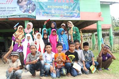 Mahasiswa KKN bersama anak-anak desa Lhok Euncien
