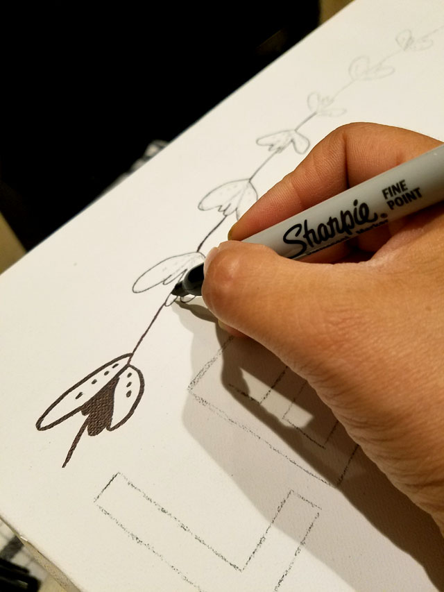 Tracing letters with a black Sharpie