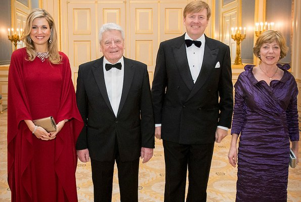 Queen Maxima and aniela Schadt attend a dinner Noordeinde Palace. Queen Maxima wore VALENTINO Silk Dress. Maxima wore diamond necklace and diamond earrings, Sergio Rossi Pumps