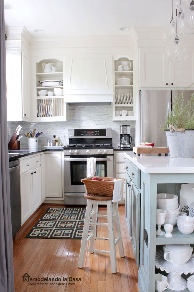 a white kitchen with duck egg blue island