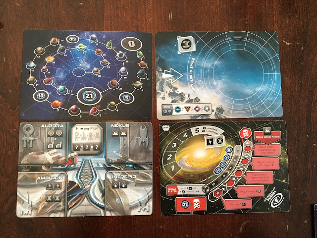 Tiny Epic Galaxies Beyond the Black Expansion by Gamelyn Games Score card, new rogue galaxies, hangar, and unexplored space cards.