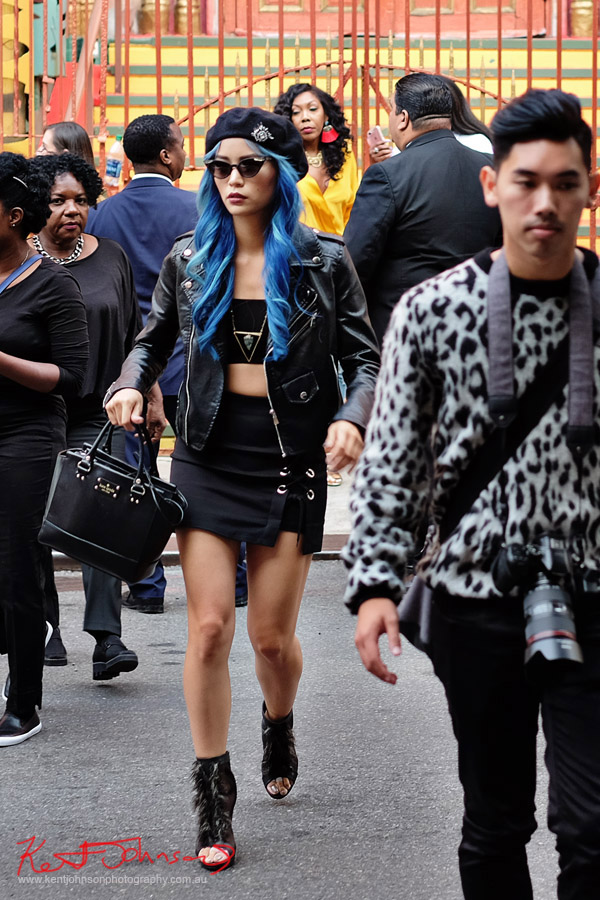 Woan in all black, crop top, beret, mini skirt, shoes and bag crosses Norfolk Street. Street Fashion Sydney - New York Edition photographed by Kent Johnson
