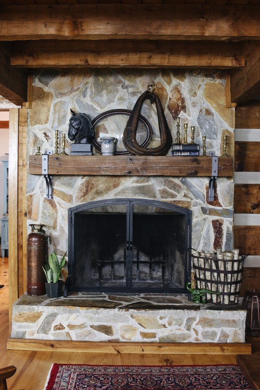 log-home-stone-fireplace-rustic-steel-beam-mantel-styling