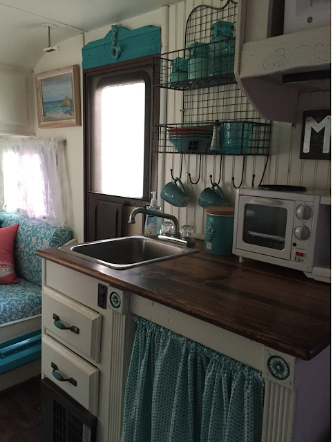 One shabby old house ready to go glamping for Campervan kitchen ideas