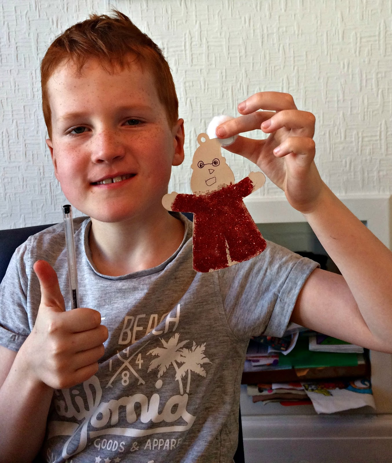 Ieuan holding the finished Santa Claus