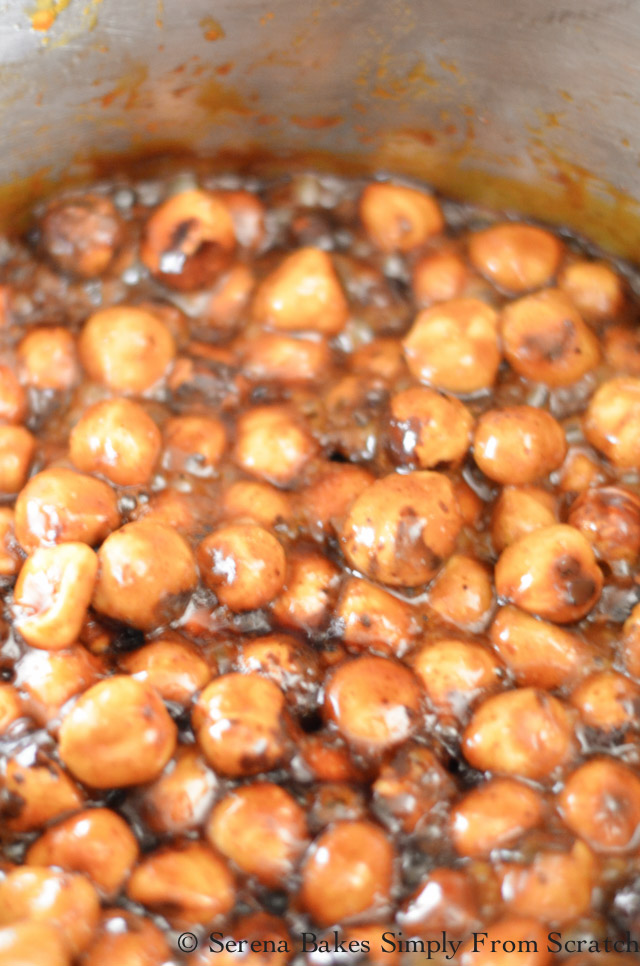 Cook Spiced Candied Hazelnuts until thick, and add vanilla.