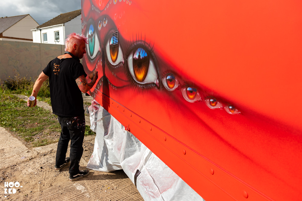 Street Artist My Dog Sighs spray painting a truck in Cheltenham, UK