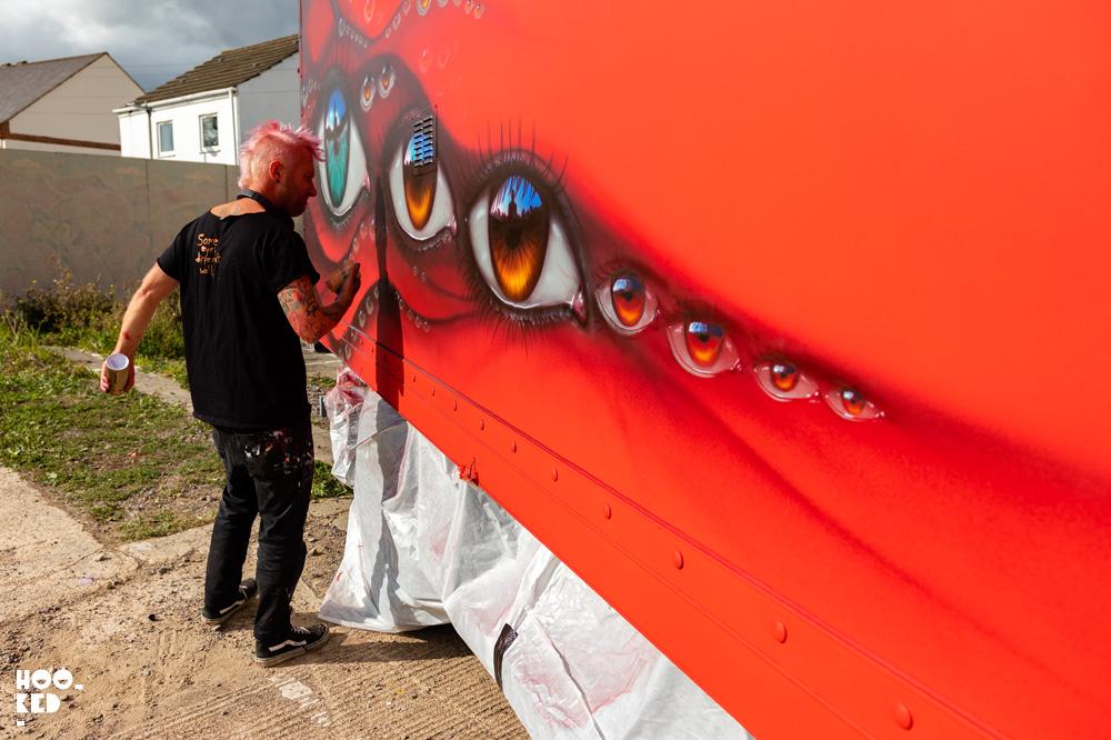 Street Artist My Dog Sighs spray painting a truck in Cheltenham, UK