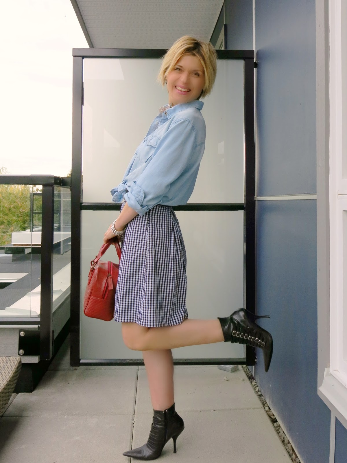 styling a gingham skirt with a chambray shirt and punk-inspired booties