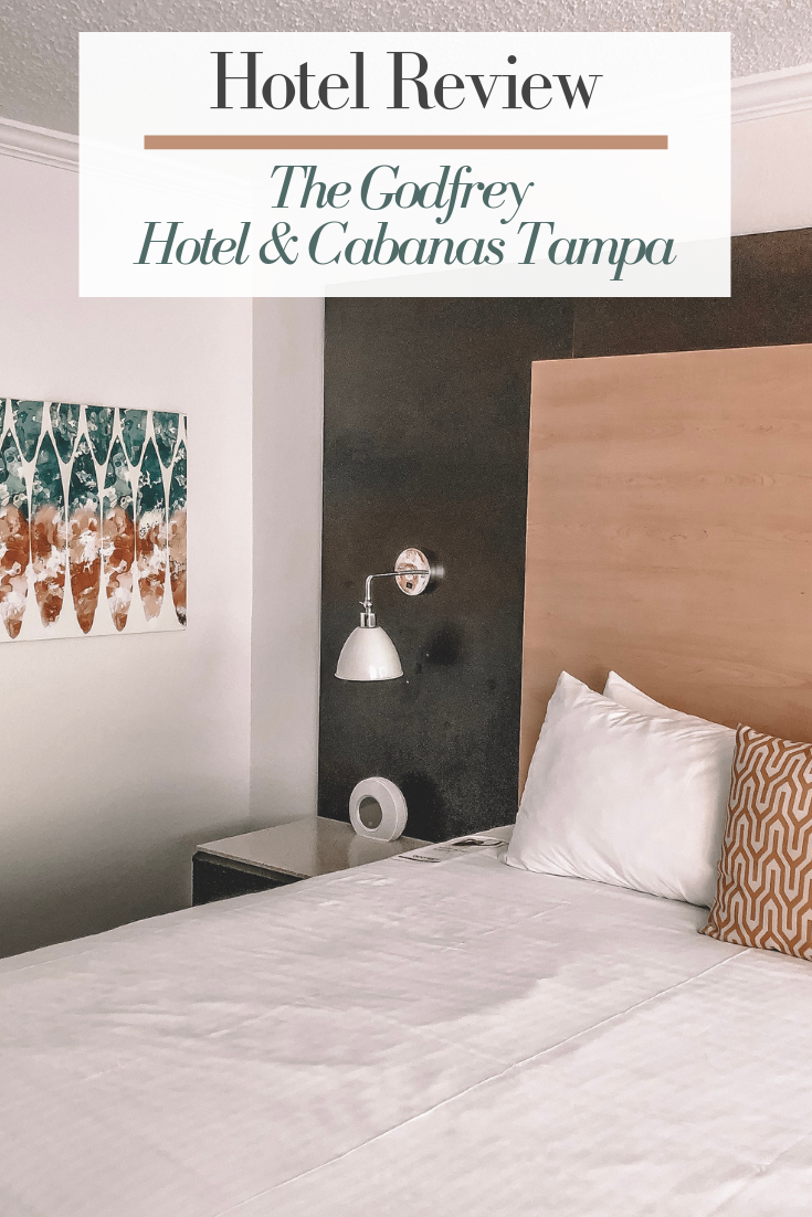hotel review of the Godfrey Hotel & Cabanas in Tampa, Florida. The photo has a picture of the king bay view room at the hotel.