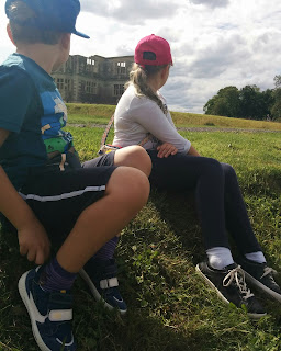Wearing our new shoes at Lyveden New Bield