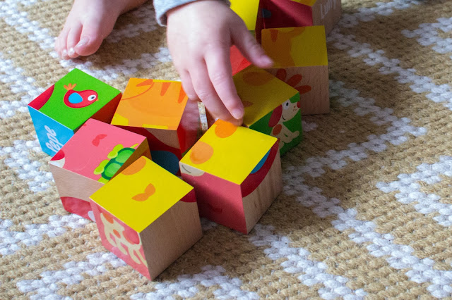 Close up picture of the friendship blocks, a little hand and little toes