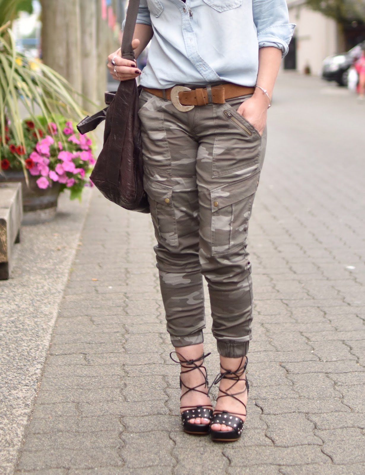 Monika Faulkner personal style inspiration - camo pants, chambray shirt, lace-up sandals, matt & nat satchel