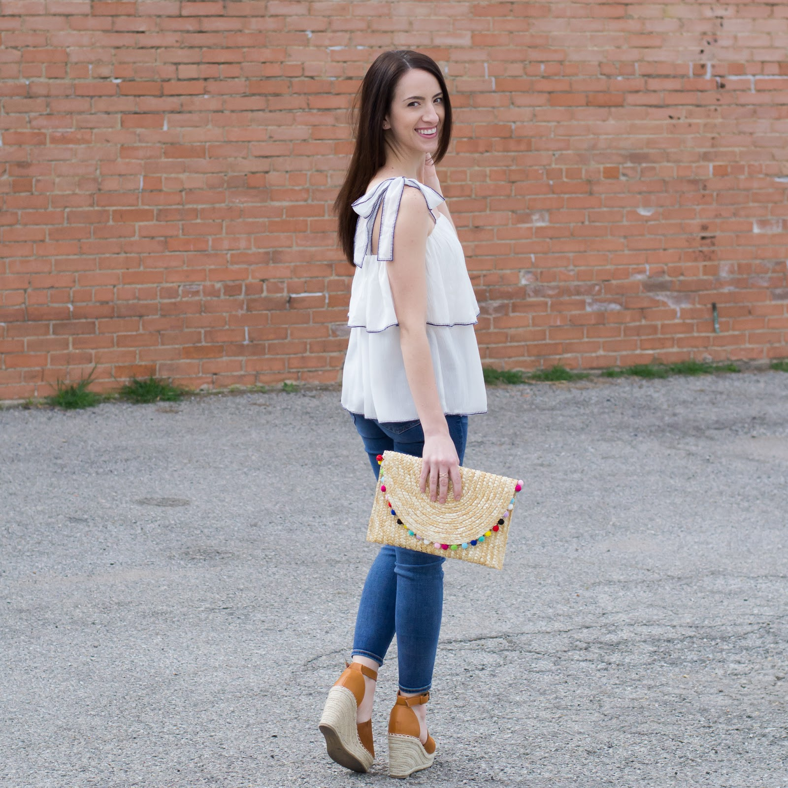 Simply and sassy style with ruffle top, pom pom clutch and wedge espradilles