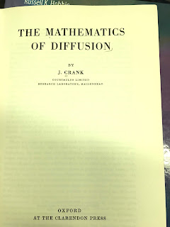 Title page of The Mathematics of Diffusion, by Crank, superimposed on the cover of Intermediate Physics for Medicine and Biology.