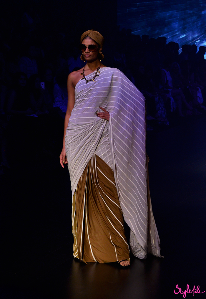 Indian model wearing a saree and turban for designer Shivan and Narresh at Lakme Fashion Week Winter Festive 2016 at St. Regis